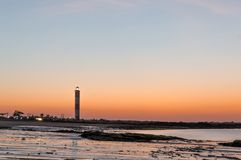 Dusk shot at Shivrajpur beach gujarat India with lighthouse and waves. This colorful shot of this famous tourist destination shows the beauty of summer stock photography
