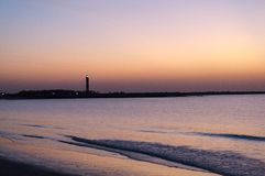 Dusk shot at Shivrajpur beach gujarat India with lighthouse and waves. This colorful shot of this famous tourist destination shows the beauty of summer stock photo