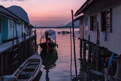 Dusk in Thai fishing village Royalty Free Stock Images