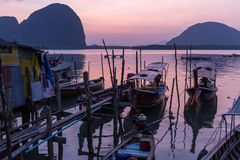 Dusk in Thai fishing village Stock Photography
