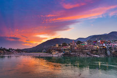 Dusk Time At Rishikesh, Holy Town And Travel Destination In India. Colorful Sky And Clouds Reflecting Over The Ganges River. Royalty Free Stock Photo