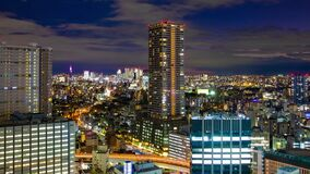 A dusk time lapse of cityscape in Tokyo high angle wide shot zoom