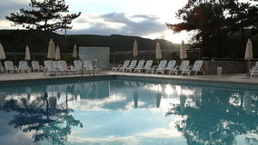 Dusk time near open air pool in a luxurious resort stock video footage