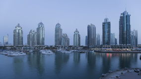 Dusk to night time lapse transition of dubai marina a modern development stock video footage