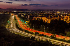 Dusk Traffic. Long-exposure light streaks of traffic at dusk over a busy road in Playa Vista, California Royalty Free Stock Photos