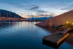 Dusk in Tromso pier with yachts in background Royalty Free Stock Photos