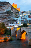 Dusk view of Alcala del Jucar with   castle and bridge Stock Images