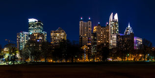 Dusk view of Midtown Atlanta, USA. Dusk view of illuminated skyscrapers of Midtown Atlanta from the Piedmont Park, USA Stock Images