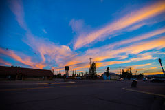 West Yellowstone at dusk. The dusk of West Yellowstone town with colored cloud and blue sky stock images