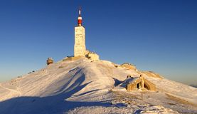 Dusk in winter at Mont Ventoux summit. The summit of Mont Ventoux covered by snow in winter Royalty Free Stock Photos