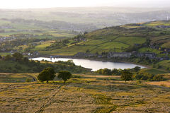 Dusk in the Yorkshire Dales. Warm sunlight sidelights a reservoir in the Yorkshire Dales Royalty Free Stock Images