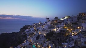 Dusk zoom in shot of the village of oia, santorini. Dusk zoom in shot of oia on the island of santorini, greece stock footage