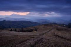 Dusky landscape in a mountain village stock image