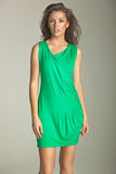 Dusky girl dressed in beautiful green dress Royalty Free Stock Photo