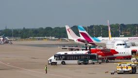 Dusseldorf airport traffic. Dusseldorf, Germany - July 22, 2017: Eurowings Airbus A320 D-AEWK, Germanwings Airbus A320, Tunisair Boeing 737 and Air Berlin stock video footage