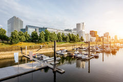 Dusseldorf city in Germany. Sunset cityscape view on the modern district at the media harbour with beautiful buildings and boats in Dusseldorf city in Germany stock image