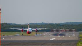 Airplane landing in Dusseldorf. DUSSELDORF, GERMANY - JULY 21, 2017: AirBerlin Bombardier DASH-8 turboprop landing at 05R runway Dusseldorf airport, evening stock footage