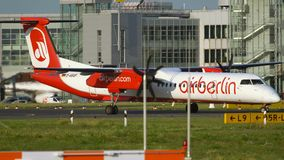 Bombardier Dash 8 of Air Berlin airlines taxiing. DUSSELDORF, GERMANY - JULY 23, 2017: Bombardier Dash 8 Q400 D-ABQP with only one engine running taxiing after stock footage