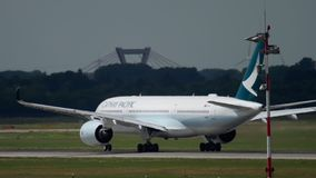 Airbus A350 departure. DUSSELDORF, GERMANY - JULY 22, 2017: Cathay Pacific Airbus A350 B-LRQ accelerate and rotate. Dusseldorf Airport, Germany stock video footage
