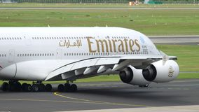 Emirates Airbus A380 taxiing. DUSSELDORF, GERMANY - JULY 23, 2017: Emirates Airbus A380 A6-EOB taxiing before departure. Dusseldorf Airport, Germany stock video