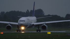 Lufthansa Airbus A330 turn on runway before departure. DUSSELDORF, GERMANY - JULY 24, 2017: Side view of Airbus A330-300 D-AIKG of Lufthansa airlines taxiing to stock footage