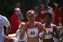 Dusseldorf marathon. One of the top 3 female favorites (Kiraz Ümmü - Turkey) on her way to the last 8 kilometres on the international Düsseldorf city marathon stock photo