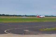 DUSSELDORF - 22nd JULY 2016: landing airplane. A landing plane at the Dusseldorf Airport stock image