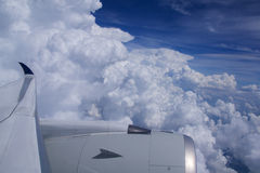 DUSSELDORF - 22nd JULY 2016: Singapore Airlines Airbus A350 clouds and blue sky through an aircraft window Royalty Free Stock Image
