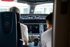 DUSSELDORF - 22nd JULY 2016: Singapore Airlines Airbus A350 cockpit inaugural flight. Singapore Airlines Airbus A350-900 cockpit with pilots preperaing the Royalty Free Stock Images