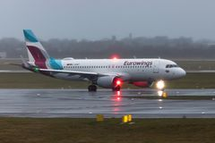 Eurowings airplane on ground at dusseldorf airport germany in the rain royalty free stock photo