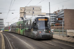 Dusseldorf tram. Accelerating away from a tram stop with motion blur Stock Photo