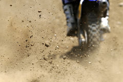 Dust. And small stones during a motocross race Stock Image