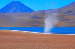 Dust above the lake. Atacama desert. Chile Stock Photos