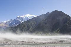 Dust being picked up by katabatic wind blowing through a dried river bed along the Annapurna Circuit, Nepal stock photos