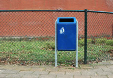 Dust bin or trash can in a Dutch street. A blue trash can or dust bin (recycle bin) in a Dutch street Royalty Free Stock Photography