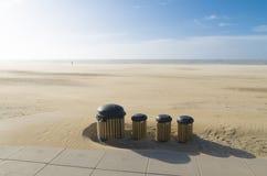 Dust bins on beach Stock Photos