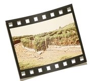 Dust-Bowl Farm. Vintage photo of old farm on filmstrip background Stock Images