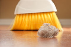Dust Bunny. A large clump of dust being swept up with a broom royalty free stock photos