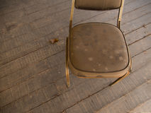 The Dust  Chair on a Wooden Floor Stock Photo
