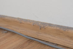 Dust cluster ball dirt on wooden floor office cable detail Stock Photography