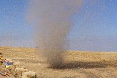 Dust devil kicking up debris. Stock Images