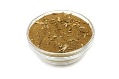 Dust of dried tobacco leaves in a glass cup Stock Images