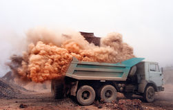 Dust explosion when loading truck at the mine Stock Photos