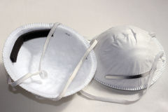 Dust Masks. Two White Elasticated Disposable Dust Masks Stock Images