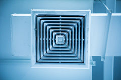 Dust out from Air Duct , Ceiling Air Grill in the office building cause of pneumonia in office man. Air Duct, Danger and the cause of pneumonia in office man Stock Photo