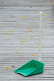 Dust pan on wooden walkway. Stock Photos