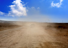 Dust road with car in  brown fog at Lanzarote Royalty Free Stock Images