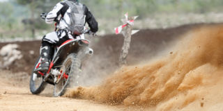 Dust splash from enduro motocycle race. Track royalty free stock photography