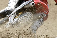 Dust and stones. Dust and small stones during a motocross race Stock Photo