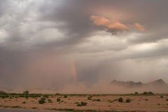 Dust Storm and Rainbow. Desert dust storm, or haboob, with rainbow at sunset Royalty Free Stock Images